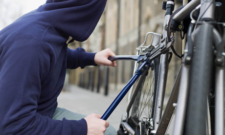 a-hooded-thief-stealing-a-001